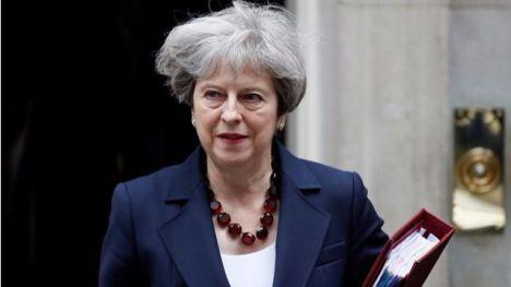 May predice largo periodo de transición para el Brexit pero no será ilimitado